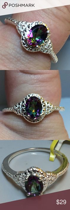 NWT! Genuine Mystic Rainbow Topaz + topaz .925 🔥Brand New! Tag On! 🔥Genuine Northern Lights Rainbow Mystic Topaz (not lab or man made!) +  White Topaz accent gems in this .925 Sterling silver (nickel free) size 7 (stamped) - Lovely brand new ring at less than used price! center stone is 1 carat . 7x 5.5 mm fancy faceted oval. 🎁earns a free new mystery thank you gift!🎁✔️top rated trusted seller! ✔️quick shipper!✔️Comes in new gift box manufacturer (usa) Jewelry Rings