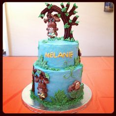 Buttercream cake. The monkeys and the tree are made with Wilton Candy Melts. The cake came from the 2013 Wilton Cake Decorating book.