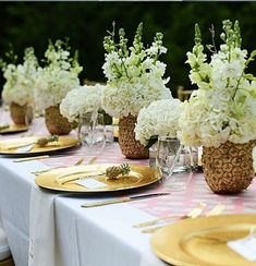 Katie Loves… an unexpected centerpiece idea, like these gilded pineapple vases from Pizzazzerie's baby shower. Paint the outside of a pineapple gold, dig out the fruit center and replace with floral foam, then add your flowers. Pineapple Vase, Pineapple Centerpiece, Pineapple Flowers, Floral Centerpieces, Flower Arrangements, Tropical Bridal Showers, Tropical Party, Gold Party, Al Fresco Dinner