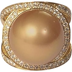 Preowned Gorgeous Golden Pearl Diamond Gold Cocktail Ring ($6,500) ❤ liked on Polyvore featuring jewelry, rings, multiple, diamond swirl ring, gold statement ring, yellow gold diamond ring, pre owned diamond rings and white gold pearl ring