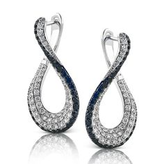 These fabulous 18K white and black gold earrings are comprised of .69ctw round white Diamonds and .54ctw black Diamonds.