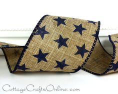 "Americana wired ribbon with a homespun look features navy blue stars on a faux linen or burlap looking tan ribbon, 2 1/2"" wide. Available from the Cottage Crafts Online shop on Etsy, where we help you make your ideas become creations."