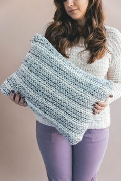 Crochet this faux knit pillow so fast and easy with chunky yarn and neutral stripes! Free crochet pattern on my blog