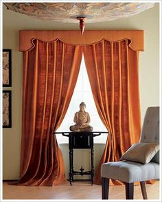 This warm burnt umber colored cornice and curtains fit in very well into this unique asian inspired room. The cornice add an extra strong and smooth look to contrast the wavy and full curtains.