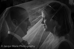 Bride with her groom under her veil, photographed by Hampshire wedding photographers Jacqui Marie Photography. VISIT http://jacqui-marie-photography.co.uk for details.  #wedding #photography #weddingphotography #Hampshire #England #uk