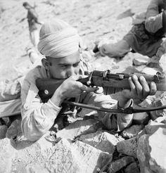 Beaton Cecil -- Cecil Beaton portrait of an Indian Tochi Scout firing his Lee Enfield rifle on the North West frontier of India, circa 1944. -- High quality art prints, canvases -- Imperial War Museum Prints