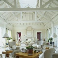 Great vaulted ceiling in a space that's tropically casual and elegant- love the peek of color through the doorways!