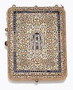 An antique sapphire, diamond and fourteen karat gold minaudiere, circa 1880  of pierced, scrolling floral motif, centering old European-cut diamonds, within a surround of square-cut sapphires, opening to reveal a beveled mirror, picture holders, under which holds a hinged arm; opposite side contains powder well, and lipstick holders, completed by oval-shaped cabochon sapphire pushpiece; weighing approximately: 237.5grams; dimensions: 3 9/16 x 2 3/4 x 9/16in.; fourteen karat gold.