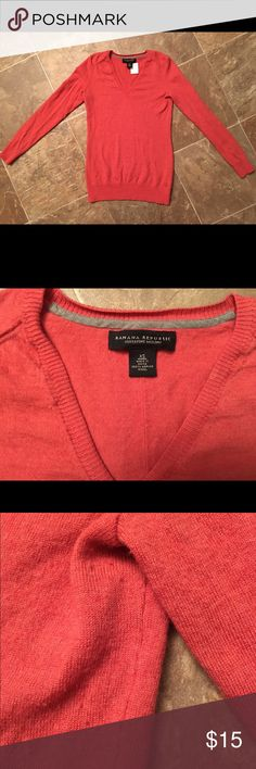 Banana republic Xs burnt orange sweater Great condition! Banana republic Xs sweater Vneck! The picture looks more brighter orange but it's more of a burnt orange color there's a little peeling under arms pits! There's a picture above! Smoke free home! Fast shipping! Banana Republic Tops Sweatshirts & Hoodies