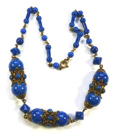 Double crown necklace with blue glass beads to imitate lapis.  Photograph by Gillian Horsup.