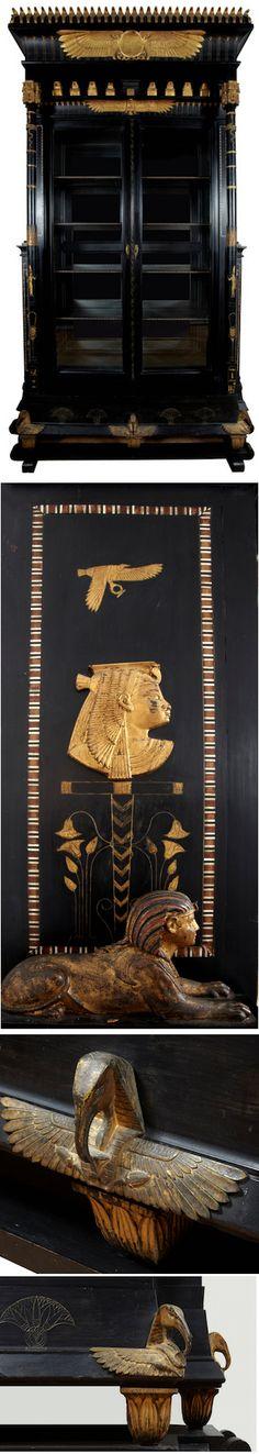 "Egyptian Revival cabinet; ebonized fruitwood, gilt wood, ormolu, plaque dated 1907, 9'-2""h,"