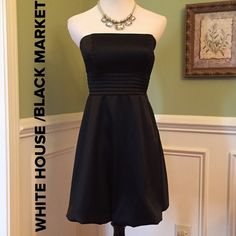"WHBM  Stunning Black Bubble Dress Gorgeous!!!  Look stunning in this Little Black Dress. Quality at its finest. Rows of pleats under the bust area sets this dress off, and of course the flirty bubble hem, you just can't go wrong. Will never go out of style. Fully lined and side zip. Measures 25"" from top to hem and laying flat waist measures 13"". Priced to sell!!! White House Black Market Dresses"