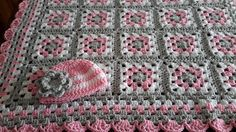 This is a soft baby blanket crocheted in a soft pink, gray and white. It is available in your choice of sizes - either one is extremely useful and decorative :] What a unique one-of-a-kind baby shower gift! The afghan comes in 26 X 31 or 31 X 31 - the choice is yours at