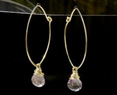 """Hand forged gold filled wire into marquee shape hoop earrings. Accented with wire wrapped dangle moss amethyst. Marquee shape is approx 1"""" wide, 1 1/2"""" long. Earrings drop about 1 3/4"""" from the earlobes."""