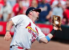 Matt Adams catches a fly ball during the ninth inning against the Washington Nationals. Cards won 5-2 6-15-14