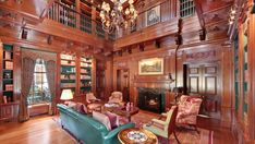 Library  Luxurious wood paneling adorns the stately two-story library, creating a nobly elegant retreat for quiet study by the fire. The bookshelves' interior is done in a rich green for a subtle pop of color.