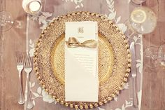 A Glass Gold Pebbled Charger, perfect for the big day #wedding #tabletop   Place Setting from P.O.S.H. Couture Rentals | Photo by Sarah Kate Photography
