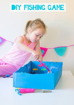 How To Make A DIY Fishing Game For Kids out of an old cardboard box and some sticks...