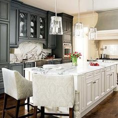 gray kitchen cabinets with white marble countertops