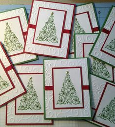 White dry embossed panel with horizontal ribbon attached was adhered to red or green card base. Tree stamped in green on smaller white panel attached to red panel to frame it. This piece then attached to rest of card. Homemade Christmas Cards, Stampin Up Christmas, Christmas Cards To Make, Xmas Cards, Homemade Cards, Embossed Christmas Cards, Holiday Cards, Chrismas Cards, Cards Diy