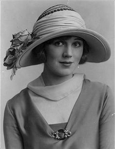 Summer Hat Caption: circa 1925: A new design for the summer hat featuring a deep brim framing the face and decorated with roses. (Photo by General Photographic Agency/Getty Images)
