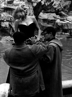 Anita Ekberg & Federico Fellini during rehearsals for Ekberg's dip in the Trevi Fountain in La Dolce Vita (1960, dir. Federico Fellini)