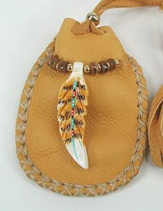 """Soaring Hawk Spirit Medicine Bag by Cynthia Whitehawk - Apache. Hand-carved & painted hawk feather totem from buffalo bone is 1 5/8"""" long; shell heishi beads, buffalo horn beads, & brass beads. ♥"""