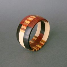 Vintage bracelet | Designer unknown.  Bone, wood, horn. Nice but I'd like to know that bone and horn are coming from natural deaths of animals, not at man's hand.