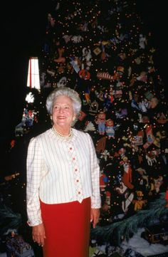 Barbara Bush is shown in front of one of the White House Christmas trees, in the Blue Room of the White House, in December of 1991.