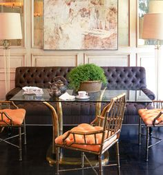 banquette + orange tufted chairs