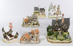 "Lot 496: David Winter Cottage Assortment; Six hand painted buildings including ""Snow Cottage"", ""Mister Fezziwig's Emporium"", ""Miner's Row"", ""Brookside Hamlet"", ""Fogartys"" and ""Spencer Hall"" signed by Winter on the underside"