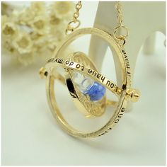 Harry Potter- Hermione's Time Turner Necklace (505 PHP) ❤ liked on Polyvore featuring jewelry, necklaces, blue, jewelry & watches, blue jewelry, unisex jewelry and blue necklace