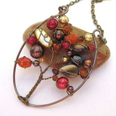 "https://flic.kr/p/6YeDfG | Autumn Tree of Life | TCET Autumn Challenge entry.  Tree of Life pendant in shades of Fall. Made with antique brass art wire and various gemstones, mother of pearl and glass beads. On a 16"" matching link chain."