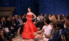 A model presents a gown from Raf Simons' first collection for Dior.