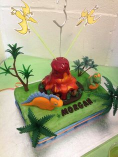 My dinosaur cake with fondant stegosaurus and t-rex and chocolate honeycomb volcano.