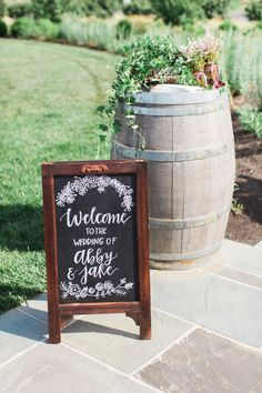 Rustic DIY-able chalkboard wedding sign: http://www.stylemepretty.com/2015/08/13/rustic-elegant-spring-wedding-at-early-mountain-vineyards/ | Photography: Abby Grace http://abbygracephotography.com/