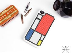 Mondrian cross stitch case for iPhone 4 and iPhone by LanasCrespo, $25.00. This is barely an accessory but SO CUTE and design-y. Cross stitch seems trendy now.
