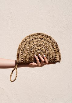 The Raffia Moon Clutch - a crochet clutch bag, delicately handcrafted with viscose raffia. Fully lined with thick cotton, features an inner pocket, zip closure, and a crochet raffia wristlet. Crochet Clutch Bags, Crochet Handbags, Crochet Purses, Crochet Wallet, Crochet Diy, Hand Crochet, Crochet Summer, Crochet Bag Tutorials, Boho Clutch