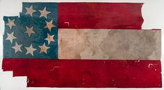 """This Confederate First National or """"Stars and Bars"""" flag was recovered on a portion of the battlefield used as a campsite by Texas, Arkansas and Missouri cavalry units, including the Third Texas Cavalry, First Arkansas Mounted Rifles, First Arkansas Cavalry (State Troops) and Missouri State Guard Cavalry."""