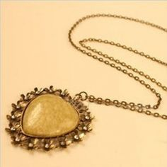 $2.99Gorgeous Hollow Floral Embellished Heart Shaped Metal Necklace