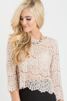 Dainty lace, quarter sleeves, crop top. You'll never need another top for all of those skirts in your closet! We...
