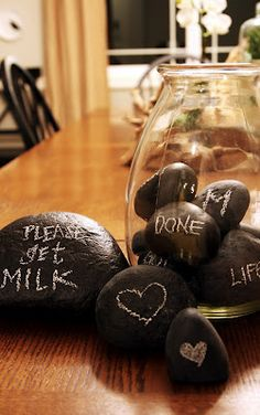 """Some the Wiser: 12 Awesome Chalkboard DIY Projects - a vase filled with rocks that say """"Love"""" and their names and maybe some other things?"""