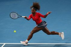 Serena Williams of United States plays a forehand during her match against Sloane Stephens of United States on day five of the Brisbane International at Pat Rafter Arena on January 3, 2013 in Brisbane, Australia