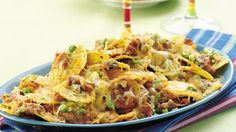 It's hard to resist a platter of crunchy, gooey nachos, especially this jalapeño-studded version loaded with cheese.