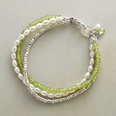 "PERIDOT AND PEARL BRACELET -- Each strand brings something unique to the mix: fresh green peridots, clean white cultured pearls and gleaming sterling silver beads. Handcrafted Sundance exclusive. Made in USA. Lobster clasp. 7-1/4""L."