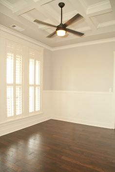 Craftsman office, hardwood floors, modern fan with remote, plantation shutters, coffered ceiling