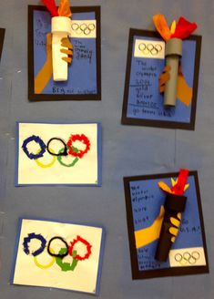 2nd Grade students are excited about the Olympic Games. First, the students traced their hand/arm and glued it to blu...