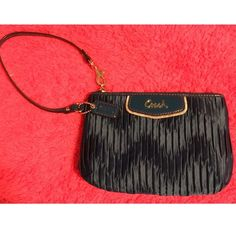 Coach wristlet Cute coach wristlet in great condition.. Only carried a few times. Navy blue. Has one inside pocket. Coach Bags Clutches & Wristlets