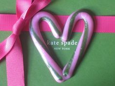 Merry Christmas from Kate Spade! <3 Wow two of my faves, Kate Spade and Candy Canes <3