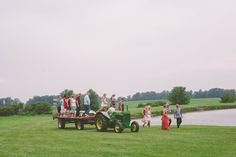 guests arrived to wedding in a hay wagon
